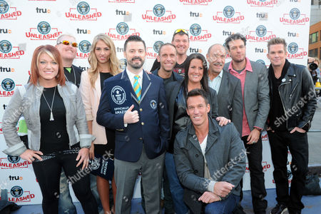 TruTV's, left to right, Amy Shirley, Ron Shirley, Liz Smith, Stuart Claxton, Seth Gold, Bobby Brantley, Ashley Broad, Dan Cortese, Les Gold, Zach Selwyn, and Mark McGrath is seen at the truTV & GUINNESS WORLD RECORDS event celebrating the premiere of the Guinness World Records Unleashed series, in New York's Times Square