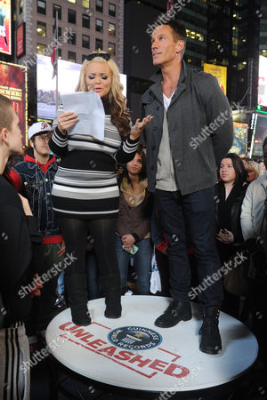 Stock Photo of Speed reader Trisha Paytas and Dan Cortese at the truTV & GUINNESS WORLD RECORDS event celebrating the premiere of the Guinness World Records Unleashed series, in New York's Times Square