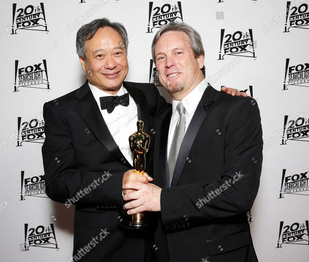 Stock Image of Director Ang Lee and Producer Gil Netter attend the Twentieth Century Fox And Fox Searchlight Pictures Academy Awards Nominees Party at Lure on in Los Angeles