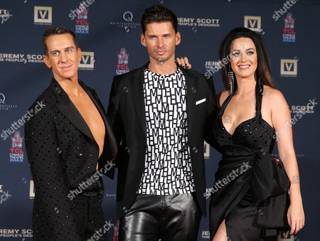 Jeremy Scott, and from left, Vlad Yudin and Katy Perry attend the World Premiere of JEREMY SCOTT: THE PEOPLE'S DESIGNER, presented by The Vladar Company and Quintessentially at the TCL Chinese Theatre, in Hollywood, Calif