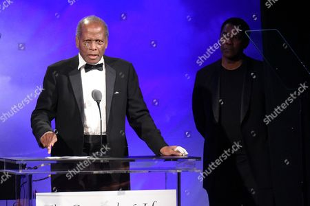 Sidney Poitier, left, and Denzel Washington are seen onstage at the 2016 Carousel Of Hope Ball held at the Beverly Hilton Hotel, in Beverly Hills, Calif