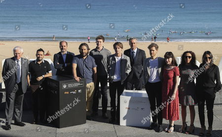 Spanish film director Sergio Gonzalez (4L) poses with actors and cast members British George Mackay (5L), British Charlie Heaton (C), Nicola Harrison (3R), US Kyle Soller (4R) and producers Belen Atienza (R), Juan Antonio Bayona (2L) and Paolo Vasile (L), during the photocall of his film 'El Secreto de Marrowbone' (Lit: The Secret of Marrowbone') at the San Sebastian International Film Festival, in San Sebastian, northern Spain, on 27 September 2017. The 65th Donostia Zinemaldia Festival runs from 22 to 30 September.
