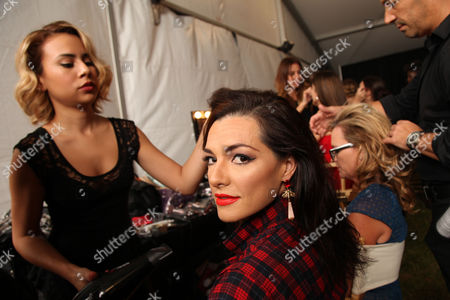 Candela Ferro poses backstage at the American Heart Association's Miami Red Dress Fashion Show during Funkshion's Fall Fashion Week Miami Beach on in Miami Beach, FL