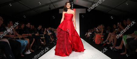 Candela Ferro walks the runway at the American Heart Association's Miami Red Dress Fashion Show during Funkshion's Fall Fashion Week Miami Beach on in Miami Beach, FL