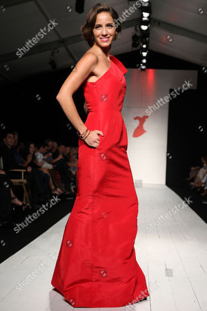 Andrea Minski, TV Host with Telemundo and Mujer Balance, walks the runway at the American Heart Association's Miami Red Dress Fashion Show during Funkshion's Fall Fashion Week Miami Beach on in Miami Beach, FL