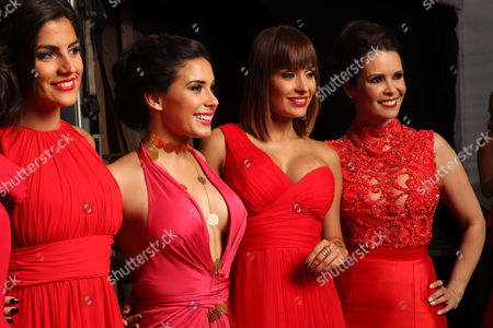 Valentina Patruno, Madai, Gaby Acuna and Real Housewives Of Miami Karent Sierra pose backstage at the American Heart Association's Miami Red Dress Fashion Show during Funkshion's Fall Fashion Week Miami Beach on in Miami Beach, FL