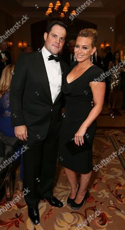 From left, Mike Comrie and actress Hillary Duff pose as the Orange County Museum of Art honors legendary Filmmaker and Visual Artist David Lynch during the 2013 Art of Dining held at the Balboa Bay Resort, in Newport Beach, Calif