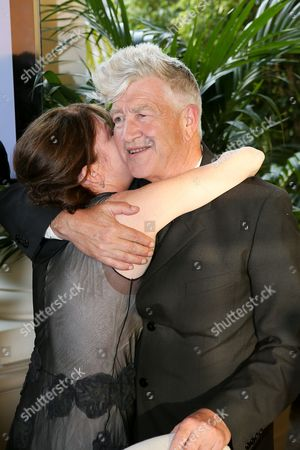 From left, actress Lara Flynn Boyle hugs artist David Lynch as the Orange County Museum of Art honors legendary Filmmaker and Visual Artist David Lynch during the 2013 Art of Dining held at the Balboa Bay Resort, in Newport Beach, Calif