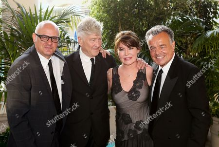 From left, Dennis Szakacs, Director and CEO Orange County Museum of Art, artist David Lynch, actress Lara Flynn Boyle and actor Ray Wise pose as the Orange County Museum of Art honors legendary Filmmaker and Visual Artist David Lynch during the 2013 Art of Dining held at the Balboa Bay Resort, in Newport Beach, Calif