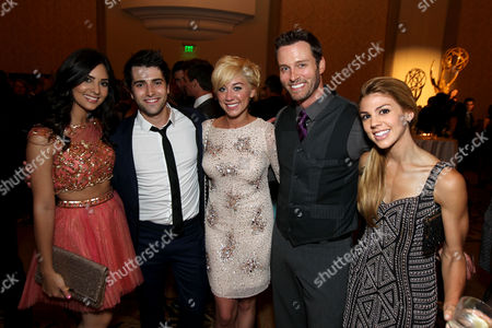 Camila Banus, left, Freddie Smith, second from left, Kate Mansi, far right, and guests attend the Daytime Emmy Nominee Cocktail Reception in Beverly Hills, Calif., on