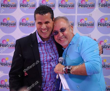 Marco Antonio Regil, left, and Emilio Estefan backstage at Festival People en Espanol 2013, on at the Alamodome in San Antonio, Texas