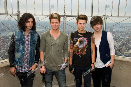 Hot Chelle Rae members, left to right, Ian Keaggy, Nash Overstreet, Ryan Follese and Jamie Follese visit the Empire State Building's 86th floor observatory, in New York