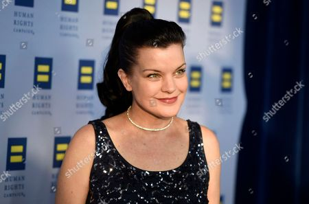 Actress Pauley Perrette poses at the Human Rights Campaign 2016 Los Angeles Gala Dinner at the JW Marriott LA Live, in Los Angeles