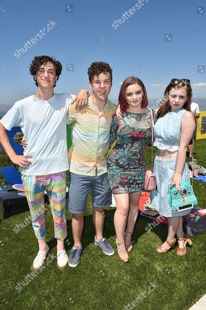 Teo Halm, from left, Nolan Gould, Joey King and Sierra McCormick attend the Just Jared 4th Annual Summer Bash presented by Uno, in Beverly Hills, Calif