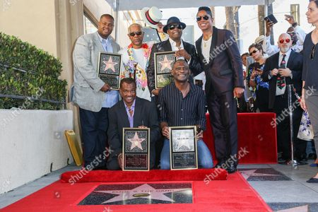 "Vincent Herbert, from left, Robert ""Kool"" Bell, Dennis ""DT"" Thomas, Ronald Khalis Bell, George Brown and Jermaine Jackson attend a ceremony honoring Kool and The Gang with a star on The Hollywood Walk of Fame, in Los Angeles"