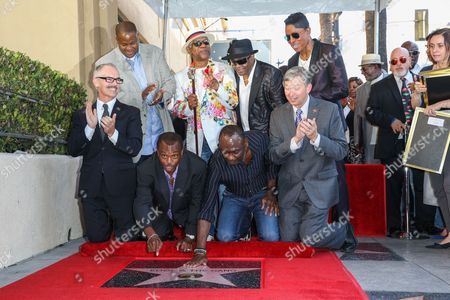 "Mitch O'Farrell, from bottom left, Vincent Herbert, Robert ""Kool"" Bell, Dennis ""DT"" Thomas, Ronald Khalis Bell, George Brown, Jermaine Jackson and Leron Gubler attend a ceremony honoring Kool and The Gang with a star on The Hollywood Walk of Fame, in Los Angeles"