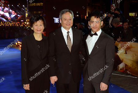 Ang Lee, centre, with wife Jane Lin, left, and son Mason Lee seen at the UK premiere of Life of Pi at the Empire Leicester Square, in London