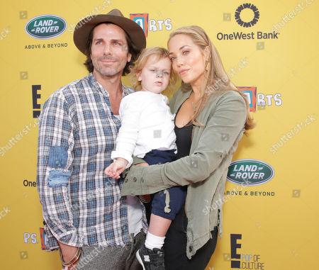 Greg Lauren, Sky Lauren and Elizabeth Berkley attend P.S. Arts Express Yourself 2014 at Barker Hanger on in Santa Monica, Calif