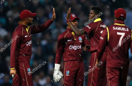West Indies' Alzarri Joseph, second right, celebrates taking the wicket of England's Jonathan Bairstow during the One Day International cricket match between England and the West Indies at the Oval cricket ground in London