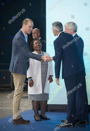 Prince William being greeted by Colleen Harris, Deputy Lieutenant for Greater London, Tony Hall, Director-General of the BBC and Tim Davie, Chief Executive Officer of BBC Worldwide
