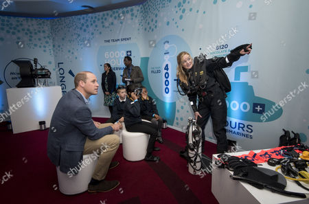 Prince William with Katie Hall, Producer for BBC NHU's Blue Planet II, wearing a rebreather and pupils from the Lionel Road Primary School Primary school, Brentford.