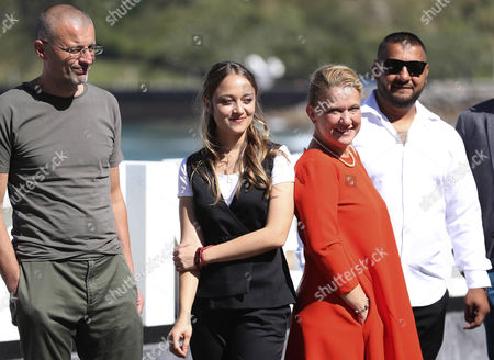 Stock Image of Serbian film director Ivana Mladenovic (2L) poses with actors and cast members Pavel Vasile Digudai (R) and Adrian Schiop (L) and producer Ada Solomon during the photocall of her film 'Soldati. Poveste din Ferrentari' at the San Sebastian International Film Festival, in San Sebastian, northern Spain, on 27 September 2017. The 65th Donostia Zinemaldia Festival runs from 22 to 30 September.