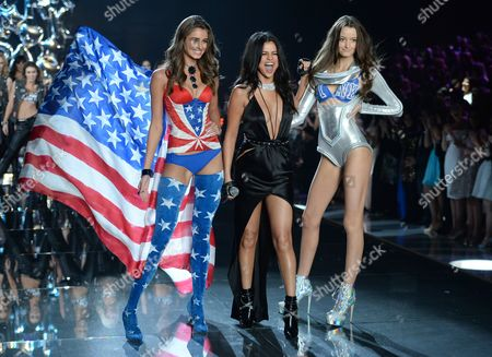 Taylor Hill, left, and Megan Puleri, right, walk the runway as Selena Gomez performs during the Victoria's Secret Fashion Show at the Lexington Armory, in New York. The Victoria's Secret Fashion Show will air on CBS on Tuesday, Dec. 8, at 10pm EST