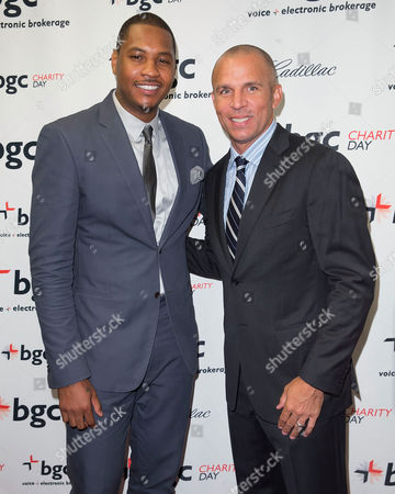 Carmelo Anthony, left, and Jason Kidd arrives at the Annual Charity Day hosted by Cantor Fitzgerald and BGC Partners, on in New York