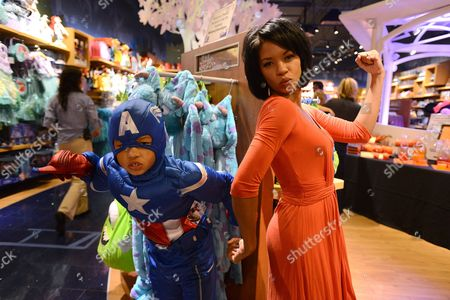 Stock Photo of Angel Parker, right, and her son James Nenninger, dressed as Captain America, pose at Disney Store's Halloween BOOtique Party, in Glendale, CA