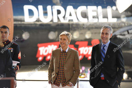 "IMAGE DISTRIBUTED FOR DURACELL - Ellen DeGeneres, center, and marketing director of Duracell Jeff Jarrett, right, celebrate the launch of the Duracell ""Power a Smile"" program that will donate up to 1 million batteries to Toys for Tots, triggered by the purchase of eligible Duracell battery packs, on in Los Angeles"