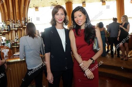 Christy Turlington Burns, left, and Monika Chiang celebrate the launch of the Tracy Anderson Method Pregnancy Project DVD series at The Top of The Standard in New York, in support of Every Mother Counts