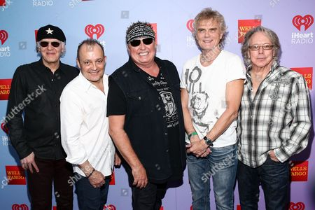 Stock Picture of Paul Dean, from left, Matt Frenette, Mike Reno, Doug Johnson and Ken 'Spider' Sinnaeve of music group Loverboy attend the iHeart80s Party held at The Forum, in Inglewood, Calif