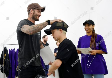 """Cruz Beckham David Beckham and his son Cruz shop together at Kanye West's """"Pablo"""" pop-up shop, in Los Angeles. The rapper-turned-fashion mogul announced plans to open 21 stores worldwide just for this weekend to sell clothing based on his latest album, """"The Life of Pablo"""