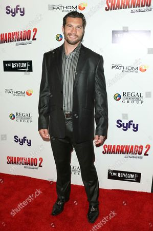 """Marcus Shirock seen at Sharknado 2: The Second One"""" at Regal Cinema at L.A. Live Theatre on in Los Angeles, California"""