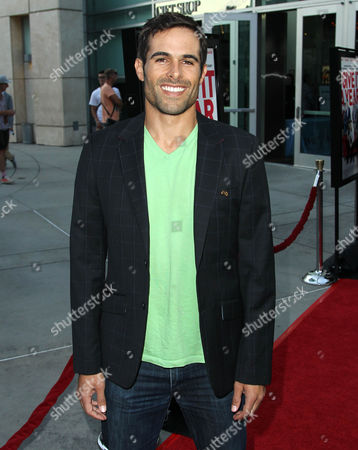 "Christopher Wolfe arrives on the red carpet at a special screening for ""I Give It A Year"" at the on in Los Angeles"