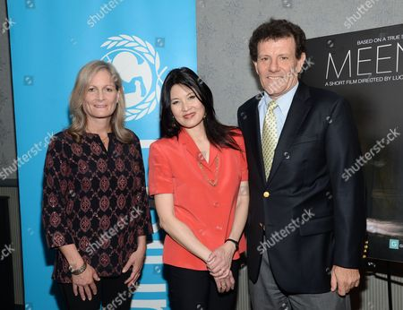 """UNICEF Child Protection Chief, Susan Bissell, left, poses with authors Nicholas Kristof and wife Sheryl WuDunn at the premiere of """"Meena"""" at the AMC Loews Theater on in New York"""