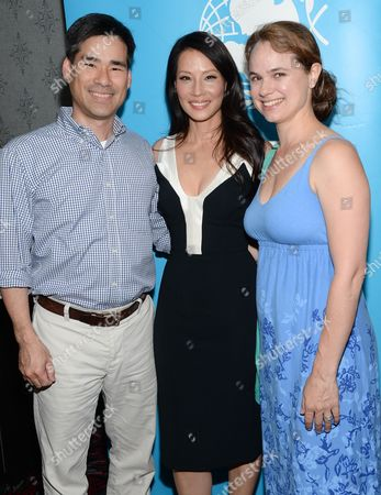 "Director and UNICEF Ambassador Lucy Liu, center, poses with her brother John Liu and his wife Stephanie at the premiere of ""Meena"", a short film on sex trafficking, at the AMC Loews Theater on in New York"