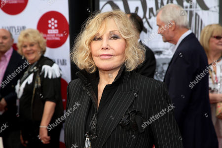 "Kim Novak arrives at the 2014 TCM Classic Film Festival's Opening Night Gala at TCL Chinese Theatre in Los Angeles. Novak says that cruel jabs about how she looked during the Oscar March 2 ceremony amounted to bullying that left her at first crushed and then determined to speak out in protest. Turner Classic Movies host Robert Osborne agreed to discuss it during an interview with Novak that preceded a festival screening last Saturday, April 12, 2014, of her film ""Bell, Book and Candle"