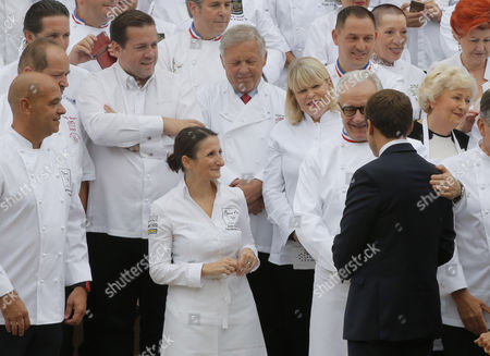 French President Emmanuel Macron, right, shakes hands with chef Alain Ducasse while the son of Paul Bocuse Jerome Bocuse looks on during an event at the Elysee Palace in Paris, France, 27 September 2017. 180 top chefs were invited to the Eylsee Palace to promote the French cuisine.