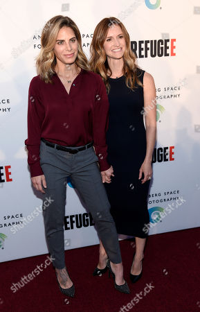"""Fitness trainer Jillian Michaels, left, and her partner Heidi Rhoades pose together at the opening of the new photography exhibit """"REFUGEE"""" at The Annenberg Space for Photography, in Los Angeles"""