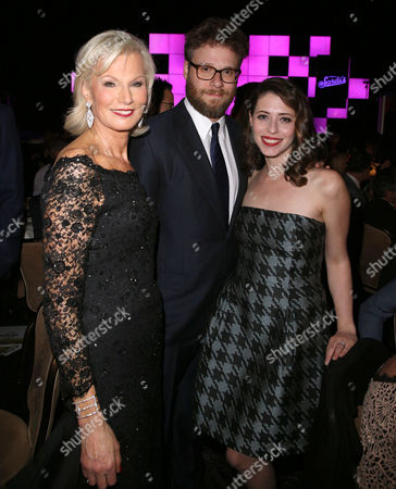 """Laurie Burrows Grad, from left, Seth Rogen and Lauren Miller attend the 24th annual Alzheimer's Association """"A Night at Sardi's"""" at the Beverly Hilton hotel, in Beverly Hills, Calif"""