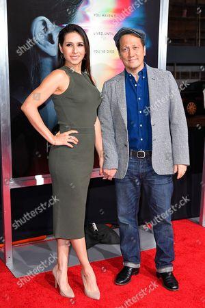 Stock Photo of Patricia Maya Schneider and Rob Schneider