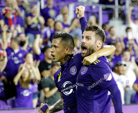 Yoshimar Yotun, Antonio Nocerino. Orlando City's Antonio Nocerino, right, celebrates his goal against the New England Revolution with teammate Yoshimar Yotun, during the first half of an MLS soccer match, in Orlando, Fla