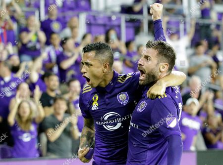 Stock Picture of Yoshimar Yotun, Antonio Nocerino. Orlando City's Antonio Nocerino, right, celebrates his goal against the New England Revolution with teammate Yoshimar Yotun, during the first half of an MLS soccer match, in Orlando, Fla