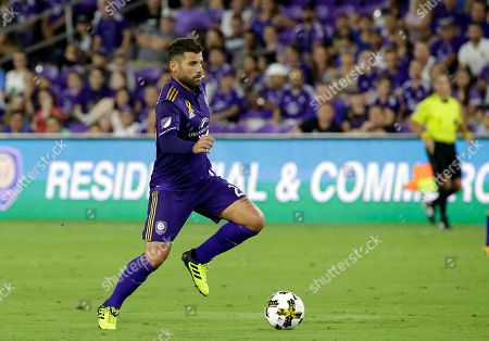 Stock Image of Orlando City's Antonio Nocerino moves the ball against the New England Revolution during the first half of an MLS soccer match, in Orlando, Fla