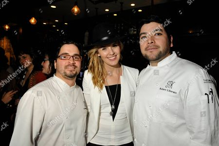 """Actress Maggie Grace poses with chefs Anthony Fusco, left, and Robert Liberato, right, at the """"We'll Never Have Paris"""" SxSw cast dinner at Supper Suite By STK hosted by Blue Moon Brewing Co.,, in Austin, Texas"""
