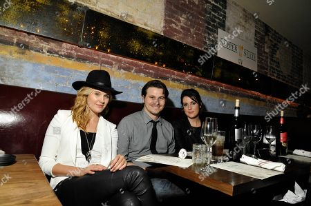 """Maggie Grace, from left, Jason Ritter, and Melanie Lynskey, pose at the """"We'll Never Have Paris"""" SxSw cast dinner at Supper Suite By STK hosted by Blue Moon Brewing Co.,, in Austin, Texas"""