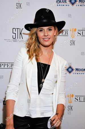 """Actress Maggie Grace poses on the red carpet at the """"We'll Never Have Paris"""" SxSw cast dinner at Supper Suite By STK hosted by Blue Moon Brewing Co.,, in Austin, Texas"""