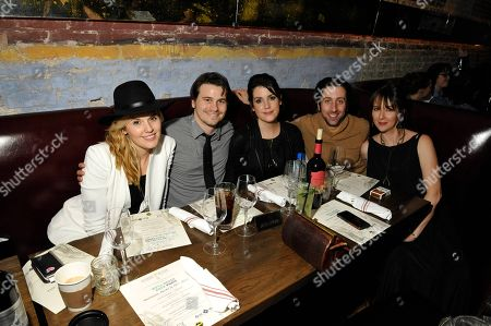 """Maggie Grace, from left, Jason Ritter, Melanie Lynskey, Simon Helberg, and Jocelyn Towne, pose at the """"We'll Never Have Paris"""" SxSw cast dinner at Supper Suite By STK hosted by Blue Moon Brewing Co.,, in Austin, Texas"""