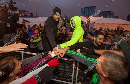 Celebrity fitness trainer Shaun T and Camren Hagan during the 9th annual Men's Health Urbanathlon presented by Polo Red by Ralph Lauren, outside Soldier Field on in Chicago